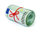 Roll of money and bow — Stock Photo