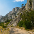 Old road in mountains — Stock Photo