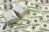 Gifts on money background — Stock Photo
