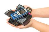 Mobile phones in woman hands — Stock Photo