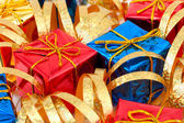 Gifts and ribbon — Stock Photo