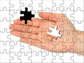 Puzzle hand without one piece — Stock Photo