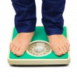 Woman feet and weight scale — Stock Photo