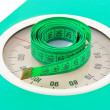 Measuring tape on weight scale — Stock Photo