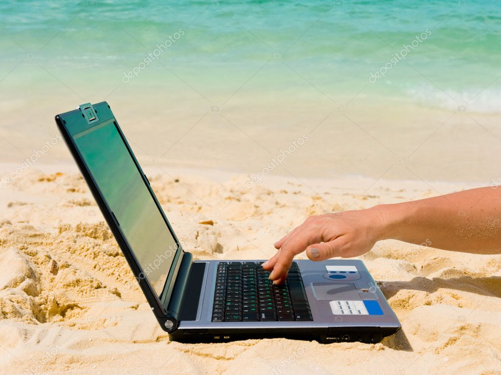 Computer and hand on beach, business travel background — Stock Photo #4219822