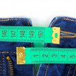 Foto Stock: Jeans and measuring tape