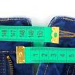 pantalones de mezclilla y cinta métrica — Foto de Stock