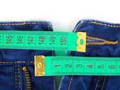 Jeans and measuring tape — Stock Photo