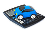 Calculator and toy car — Stock Photo