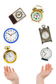 Juggling hands and clocks — Stock Photo