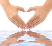 Heart made of hands and water — Stock Photo