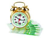 Alarm clock and money — Stock Photo
