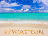 Word Vacation on beach — Stock Photo