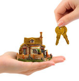 Hands with house and keys — Stock Photo