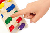 Hand and abacus — Stock Photo