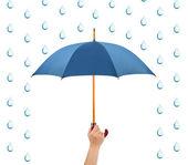 Hand with umbrella and rain — Stock Photo