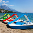 Multicolored catamaran on beach — Stock Photo
