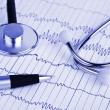 Stock Photo: Stethoscope and pen on ecg
