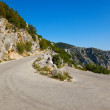 Old road in mountains — Stock fotografie