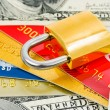 Credit cards, money and lock — Stock Photo #4254844