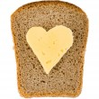 Bread and heart shaped cheese — Stock Photo #4256461