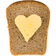 Bread and heart shaped cheese — Stock Photo