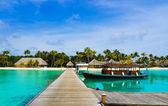 Boat moored at tropical island — Stock Photo