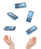 Juggling hands and phones — Stock Photo