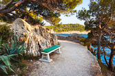 Pathway, bench and sea — Stock Photo