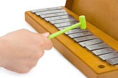 Hand and xylophone — Stock Photo