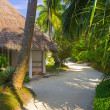 Stock Photo: Bungalows on beach and sand pathway