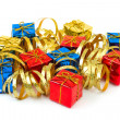 Multicolored gifts and serpentine — Stock Photo