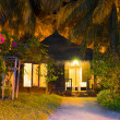Stock Photo: Beach bungalow at night