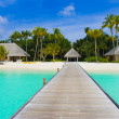 Beach bungalows on a tropical island — Stock Photo