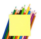 Multicolored pencils and paper — Stock Photo