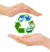 Hands and recycling sign — Stock Photo