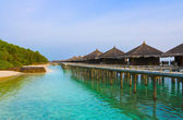 Water bungalows on a tropical island at evening — Stock Photo