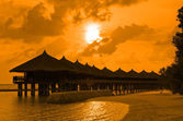Water bungalows and sunset — Stock Photo