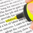 Hand with highlighter and word solution — Stockfoto