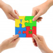 Hands and puzzle Team — Stock Photo #4277232