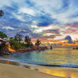 Cafe on tropical beach at sunset - Stock Photo