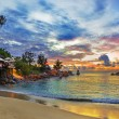 Cafe on tropical beach at sunset - Foto Stock