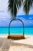 Wedding archway at tropical beach — Stock Photo
