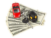Toy car, keys and money — Stock Photo