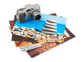 Camera and photo printouts (my photos) — Stockfoto