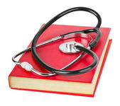 Stethoscope and book — Stock Photo