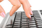 Computer keyboard and hand — Stock Photo