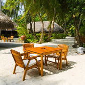 Cafe on the beach of tropical island — Stock Photo