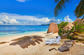 Chairs on tropical beach — Stock Photo
