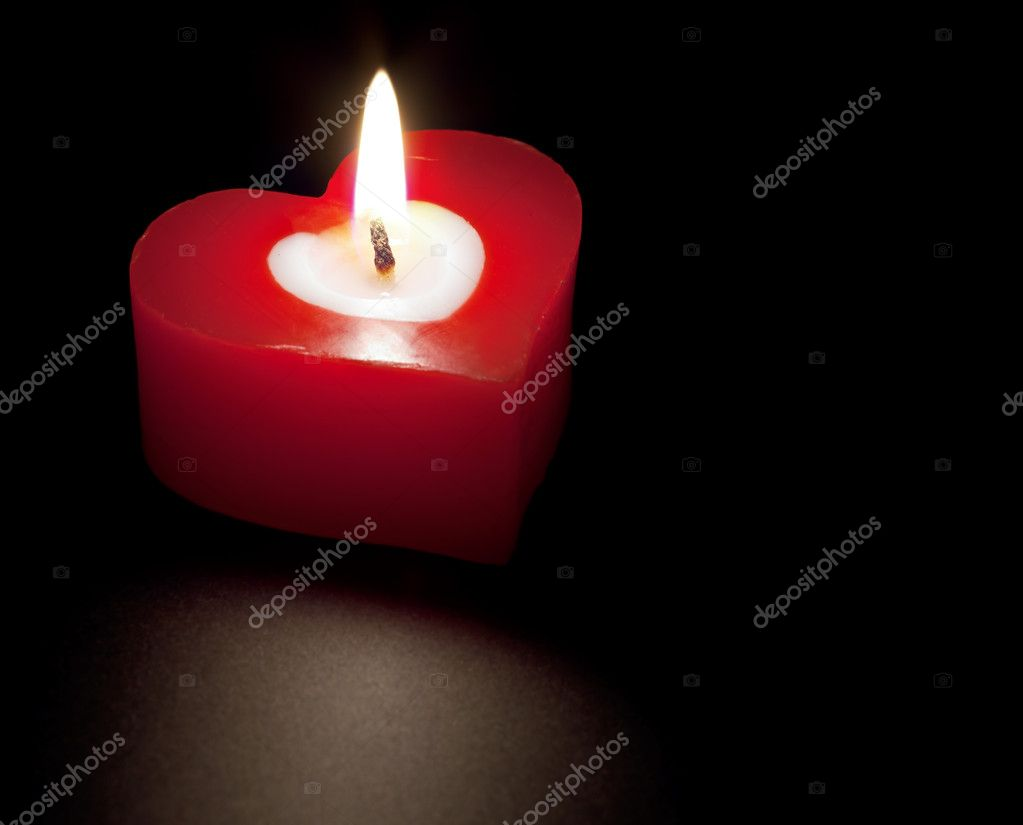 Heart shaped candle isolated on black background — Stock Photo #4277057